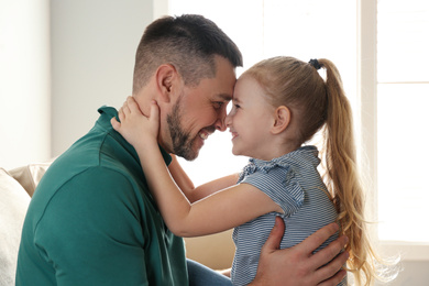 Dad and daughter spending time together at home. Happy Father's Day
