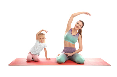Young woman and her daughter doing exercise isolated on white. Home fitness