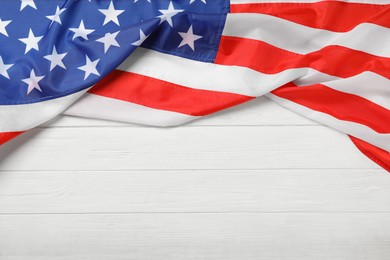 American flag on white wooden table, top view with space for text. Memorial Day
