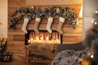 Stylish room interior with decorative fireplace. Christmas time