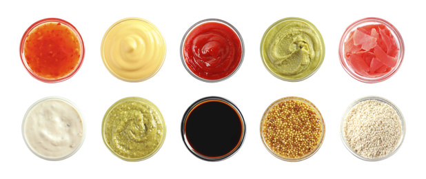 Set of different delicious sauces and condiments on white background, top view. Banner design