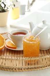 Delicious orange marmalade served with tea for breakfast in tray