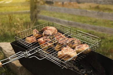 Cooking tasty meat on barbecue grill outdoors