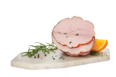 Delicious cut ham with herbs, orange slice and peppercorns isolated on white