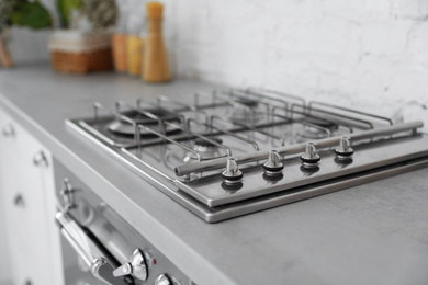 New modern stove with gas burners in kitchen, closeup