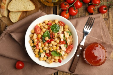 Delicious fresh chickpea salad served on wooden table