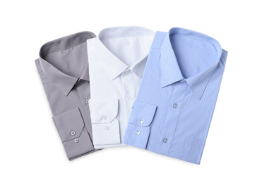Stylish shirts isolated on white, top view. Dry-cleaning service