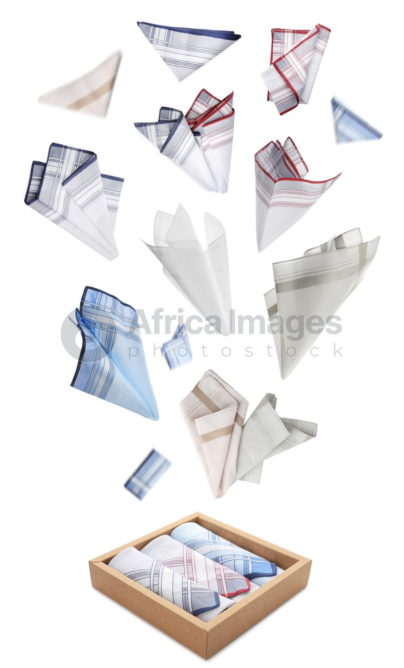 Many different handkerchiefs falling into box on white background