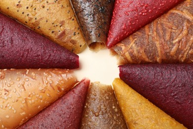 Delicious fruit leather rolls on beige background, closeup