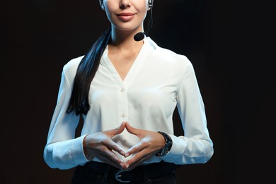 Motivational speaker with headset performing on stage, closeup