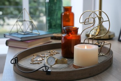 Stylish tray with different interior elements on wooden table near window