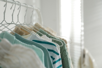 Rack with stylish women's clothes indoors, space for text. Interior design