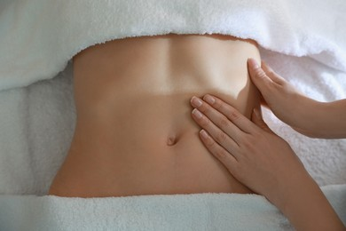 Woman receiving professional belly massage, closeup view