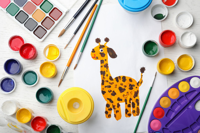 Flat lay composition with child's painting of giraffe on white wooden table