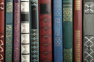 Collection of different old books as background
