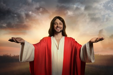 Jesus Christ with outstretched arms outdoors