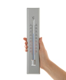 Woman holding weather thermometer on white background, closeup