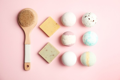 Flat lay composition with bath bombs, brush and soap bars on color background
