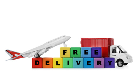 Different logistics transport and cubes with words FREE DELIVERY isolated on white. Logistics and wholesale concept