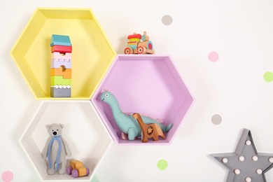 Bright colorful shelves on light wall. Interior design