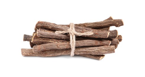 Dried sticks of liquorice root on white background