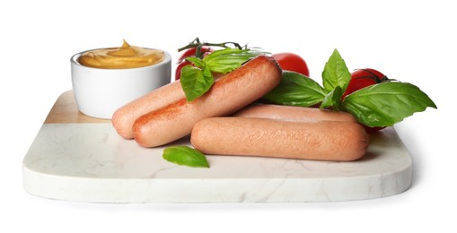 Delicious vegetarian sausages with basil, tomatoes and sauce on white background