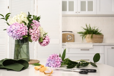 Bouquet of beautiful hydrangea flowers on white table indoors. Interior design