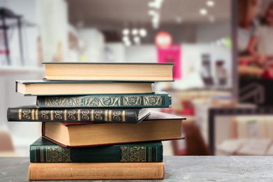 Collection of different books on table against blurred background