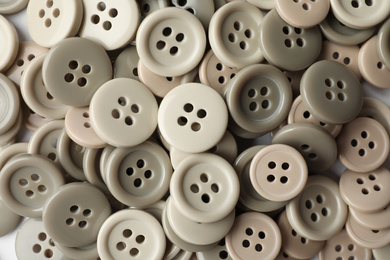 Many plastic sewing buttons as background, closeup