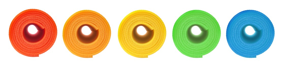 Set with different bright rolled camping mats on white background. Banner design