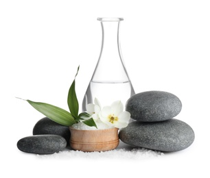 Composition with spa stones and sea salt on white background