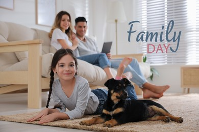 Little girl with puppy lying and her parents sitting on sofa in living room. Happy Family Day