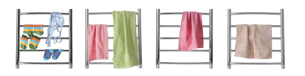 Set with modern heated towel rails with clothes and towels on white background. Banner design