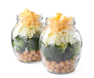 Healthy salad in glass jars isolated on white