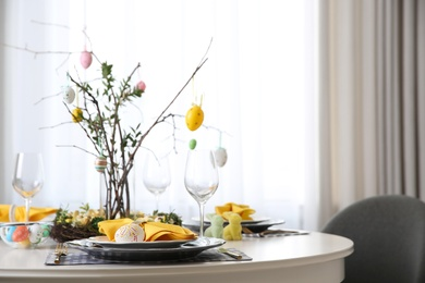 Beautiful Easter table setting with floral decor indoors