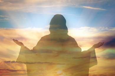 Silhouette of Jesus Christ and cloudy sky, double exposure