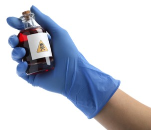 Woman in gloves holding glass bottle of poison with warning sign isolated on white, closeup