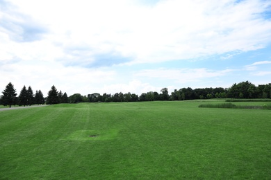 Beautiful view of golf course with green grass