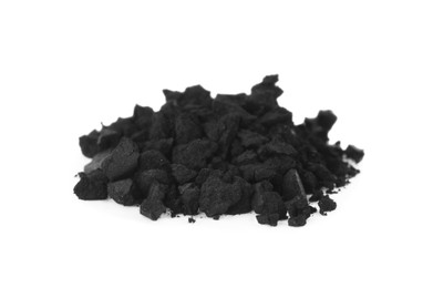 Pile of crushed activated charcoal pills on white background. Potent sorbent