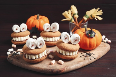 Delicious Halloween themed desserts on wooden table