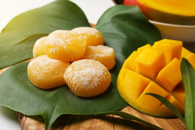 Composition with delicious mochi and mango on table. Traditional Japanese dessert