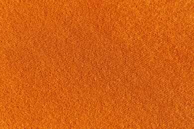 Orange textured surface as background, closeup view