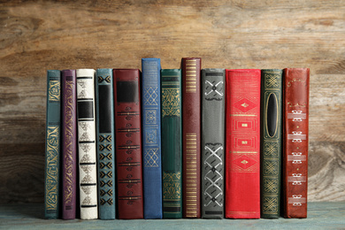 Collection of old books on wooden shelf