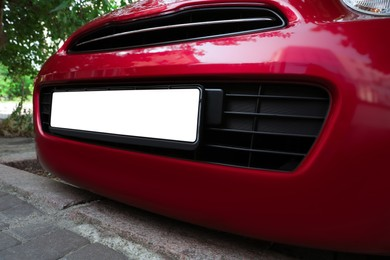 Car with vehicle registration plate outdoors, closeup. Mockup for design