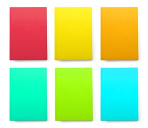 Set with different multicolored planners on white background, top view