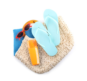 Bag with beach objects on white background, top view
