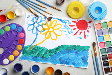Flat lay composition with child's painting of meadow with flowers on marble table