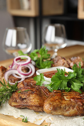 Delicious roasted chicken tobacco with herbal on wooden board, closeup