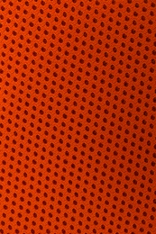 Texture of orange fabric as background, top view