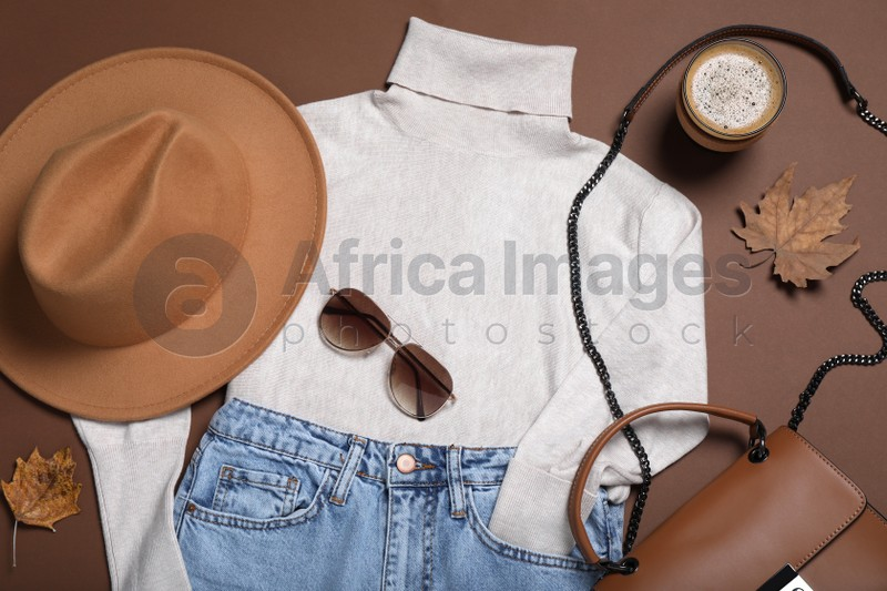 Flat lay composition with stylish hat and clothes on brown background